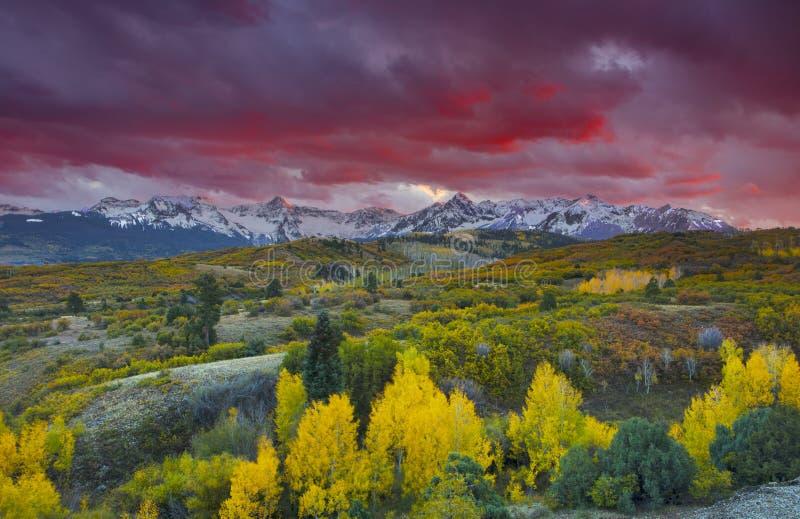 Sun setting over San Juan Mountain range and Autumn Fall color of the Dallas Divide Ridgway, Colorado, America stock photos