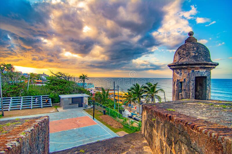 Sun setting Over San Juan Puerto Rico. Walking out to the Atlantic ocean from the Crisibol  Ford in San Juan Puerto Rico as the sun sets royalty free stock photos