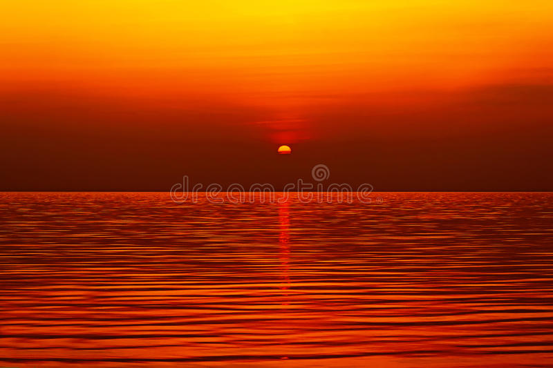 Sun setting over the sea stock image