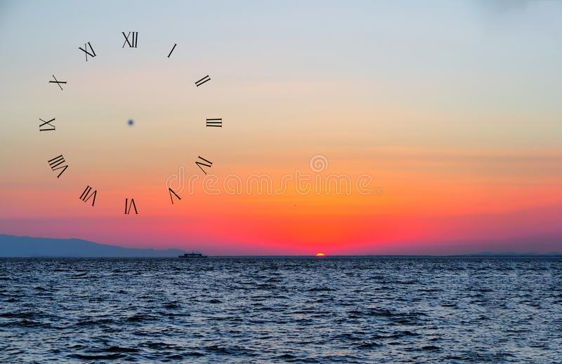 Sun setting over the sea and ship in turkey for wall clock royalty free stock photography