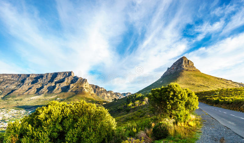 Sun setting over Table Mountain, Lions Head and the Twelve Apostles royalty free stock photos