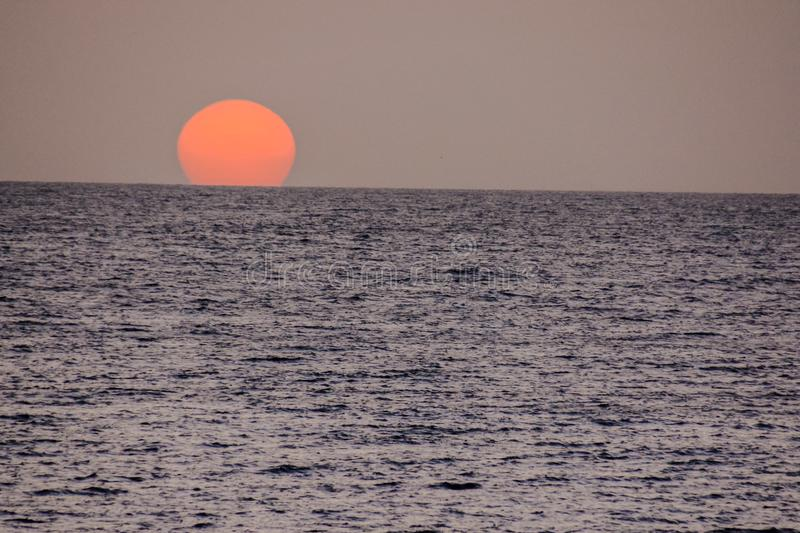 The Sun Setting in the Sea. Photo Picture of The Sun Setting in the Sea stock photography