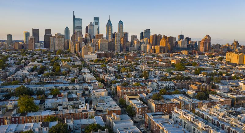 The Sun is Setting on the South Side of Downtown Philadelphia Pennslyvania. Aerial view over the neighborhoods and streets of Philadelphia PA USA royalty free stock images