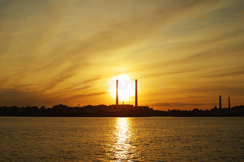Download Sun Settings Behind Power Pipes Stock Photo - Image: 11260980