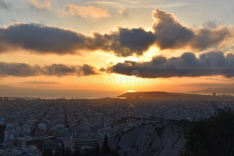 The Sun sety Nad Ateny zdjęcie stock