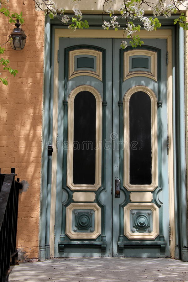 Sun and shade on old wood doors stock image