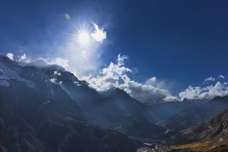Annapurna Valley with blue sky and deep Himalayan valley. royalty free stock photos