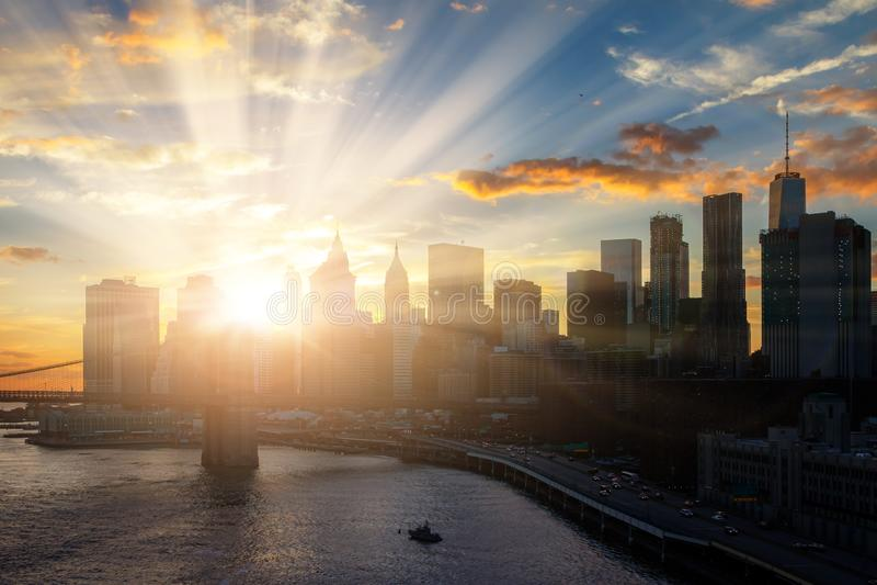 Sun shines on New York City downtown Manhattan skyline. Sun shines down on New York City downtown Manhattan skyline stock images