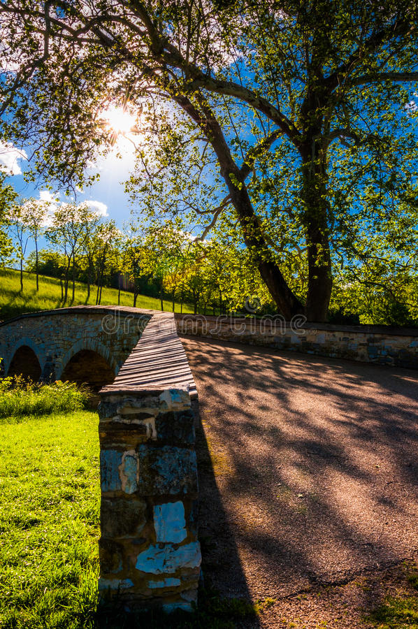 The sun shines through trees over Burnside Bridge, at Antietam National Battlefield. Maryland royalty free stock photography