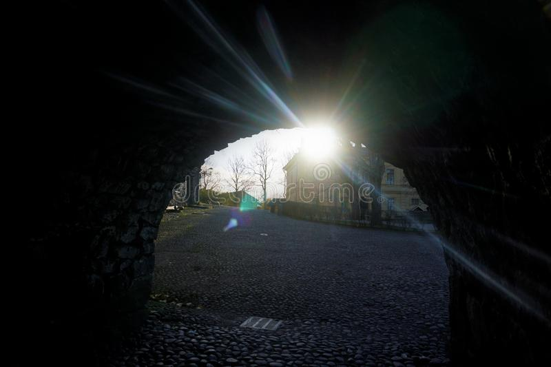The sun shining through an archway on Suomenlinna stock photos