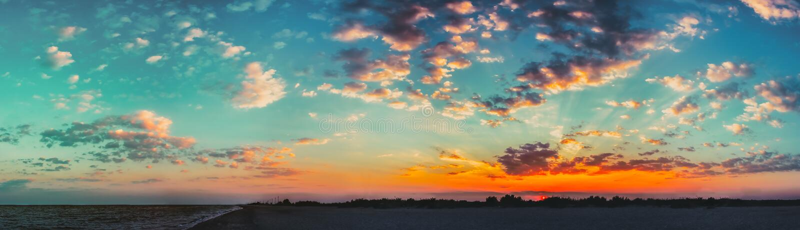Sun Shining On Horizon During Sunset Sunrise. Panorama Of Sea Oc stock photo