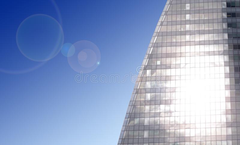 Sun shining with lens flare in modern business building royalty free stock images