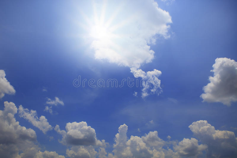 Sun shining over blue sky with white cloud day light stock photos