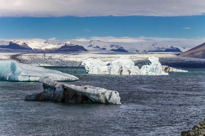 Large Ice burgs float effortlessly around Jokulsarlon Glacier Lagoon in Iceland royalty free stock image