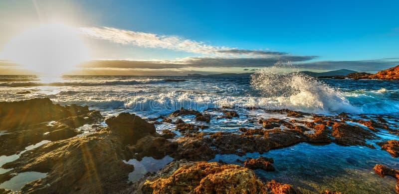 Sun shining over the rough sea at sunset. Sardinia, Italy royalty free stock image