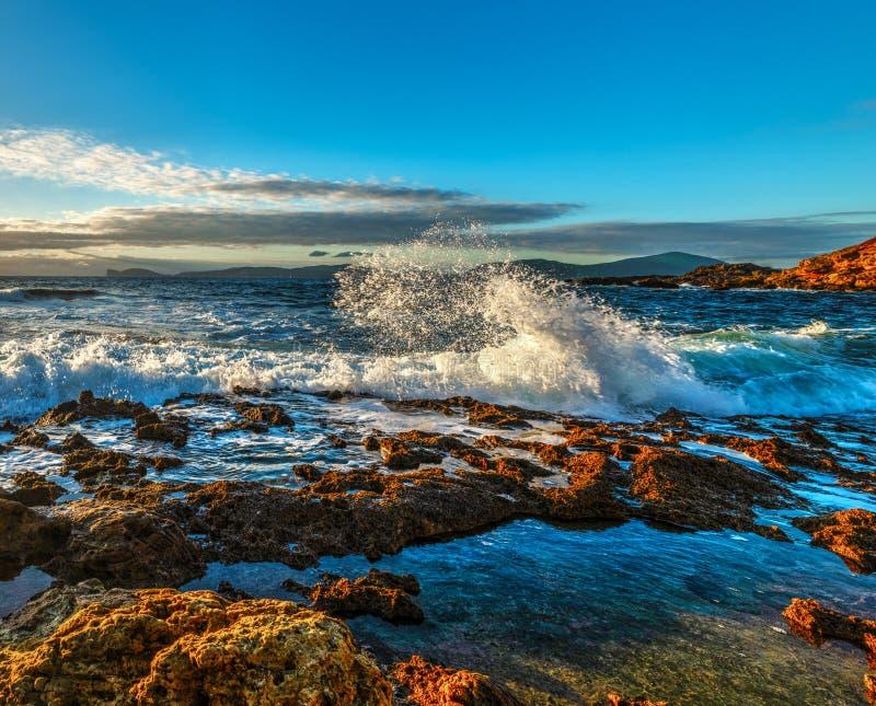 Sun shining over the rough sea at sunset. Sardinia, Italy stock image