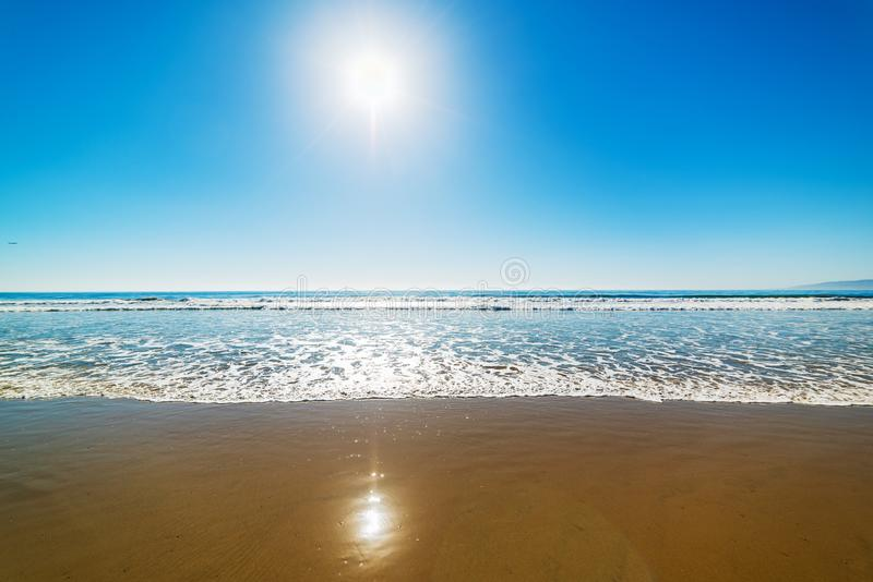 Sun shining over Santa Monica beach on a clear day royalty free stock photo