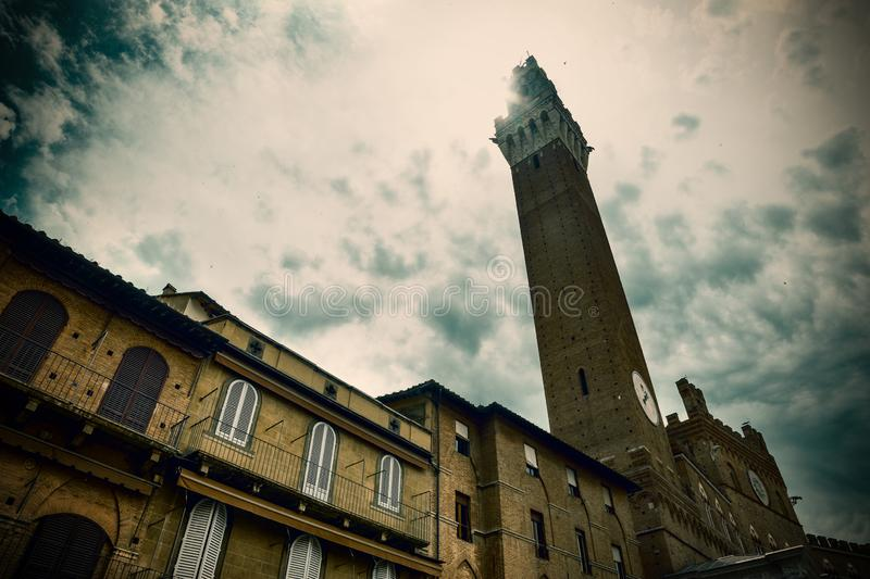 Sun shining over Torre del Mangia in Piazza del Campo stock images