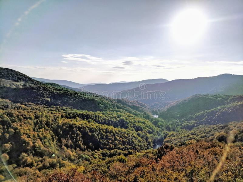 Sun shining over the valley in autumn sunny day stock photography