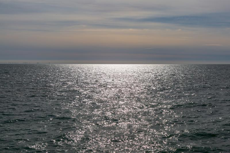 The Sea off the Coast at Brighton. The sun shining on the sea at Brighton, Sussex royalty free stock images