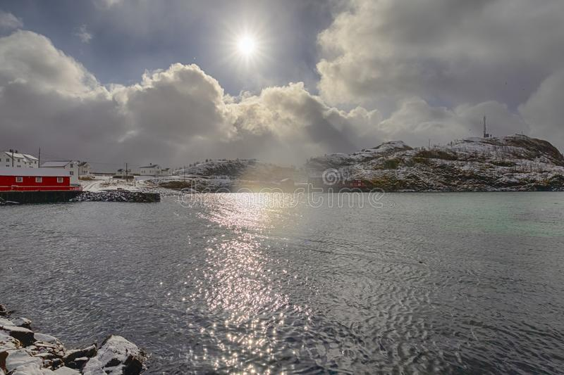 Sun Shining Through the Skies in Little Fishing Village. Hamnoy and Sakrisoy on Lofoten in Norway in Early Spring Time. Horizontal image royalty free stock photos