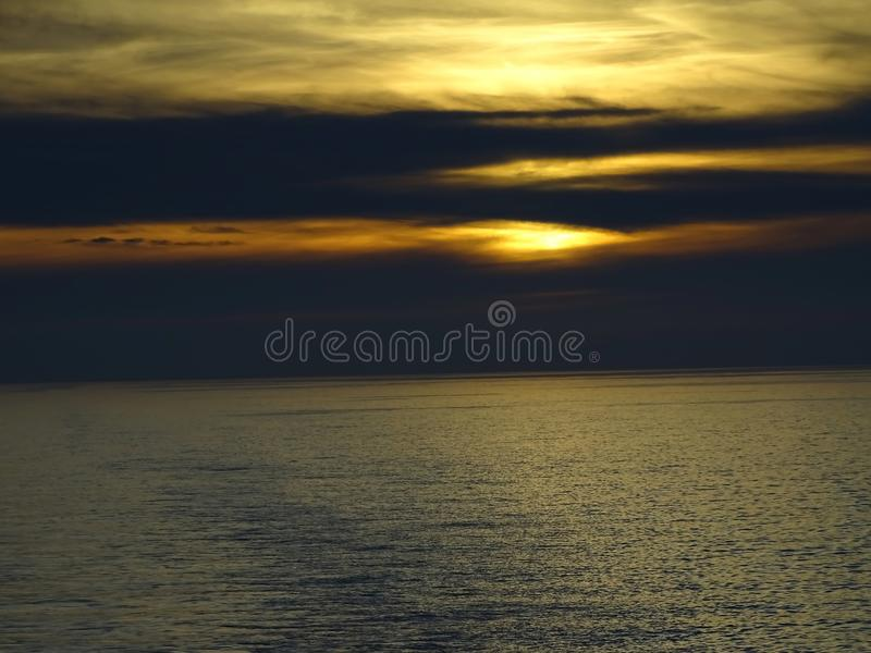 The sun sinks in the sea. On the car ferry Amsterdam-Newcastle, June 2018 royalty free stock images
