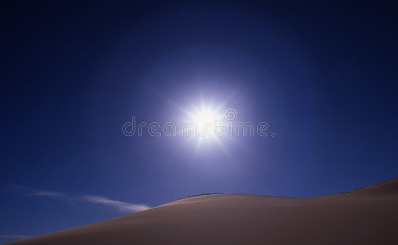 Sun, sky and dunes stock images