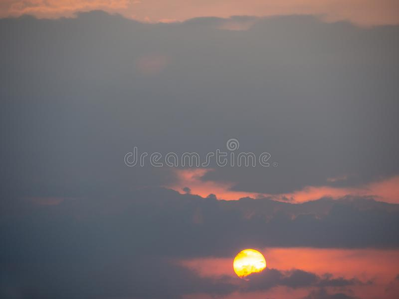 The sun in the sky in the evening time.  royalty free stock photos