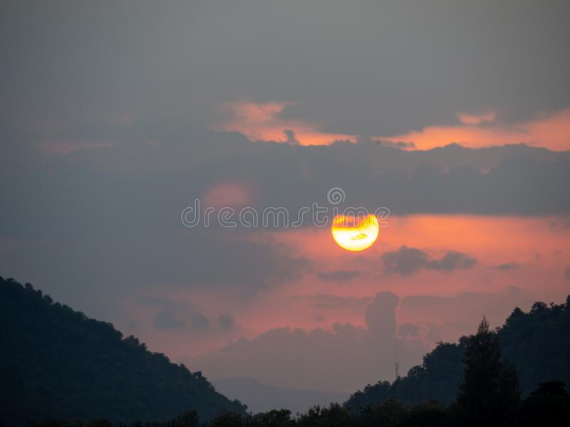The sun in the sky in the evening time.  royalty free stock images