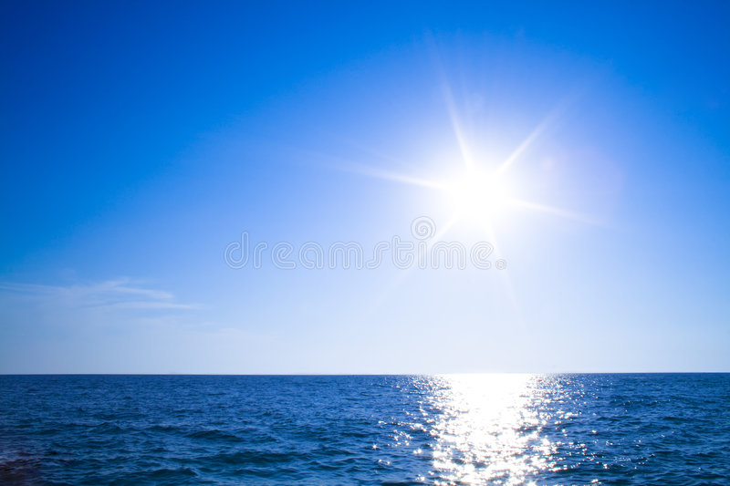 Sun, sky and ocean royalty free stock image