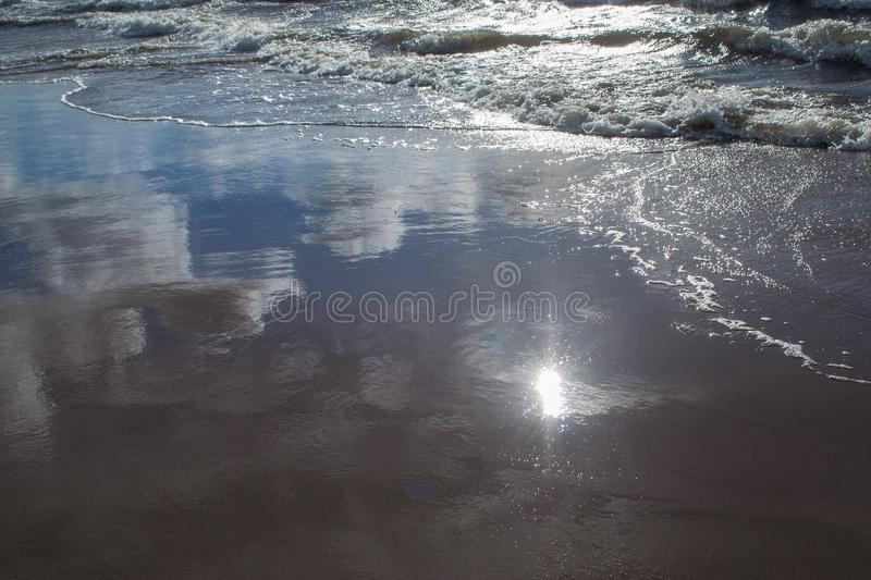 Sun and sky reflections royalty free stock image