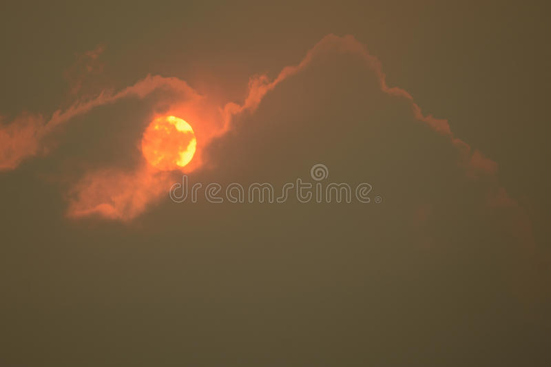 Sun smoke and clouds royalty free stock photos