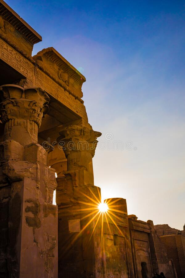Free Sun Starburst Peaks Between Hieroglypic Carvings At The Entrance To Ancient Tempp0le Of Kom Ombo Stock Photos - 189838243