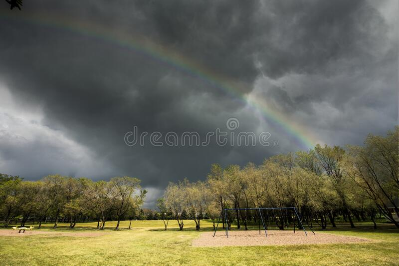 Sun and Storm in Warman stock photo