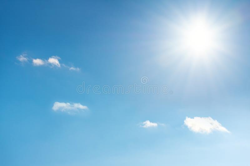 Sun with sunrays on the blue sky with white clouds. Daytime and good weather royalty free stock photos
