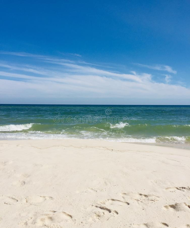 Sun, surf and sand stock images