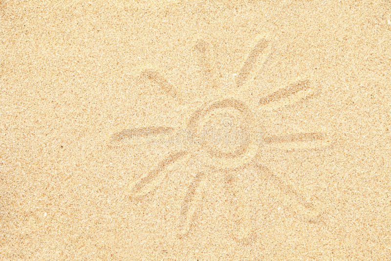 Sun teckning på sanden royaltyfria foton