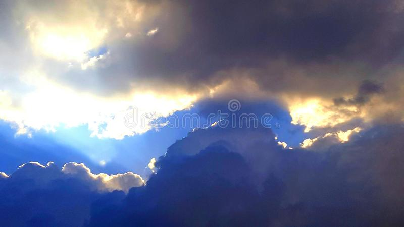 Sun trapped behind clouds royalty free stock photo