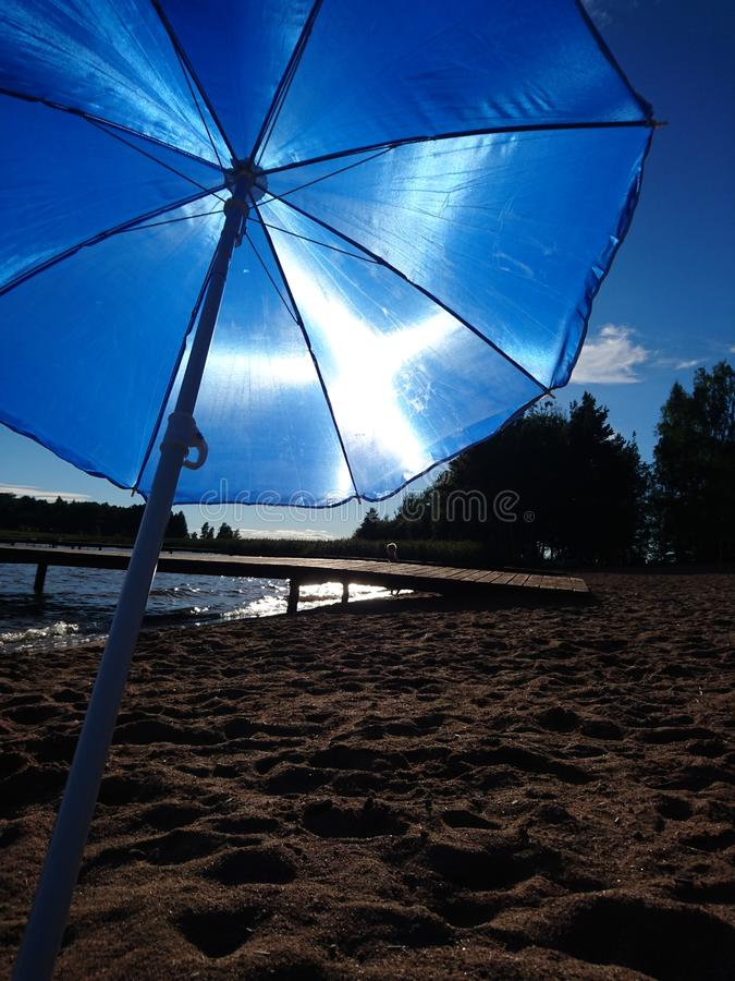 Sun umbrella att The beach summer 2016. Blue Sun umbrella att The beach stock photography
