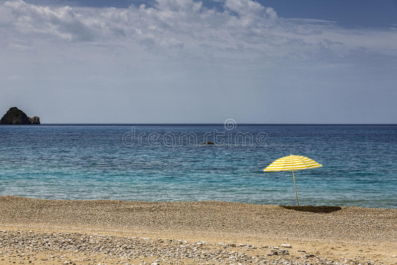 Sun umbrella on the beach stock image