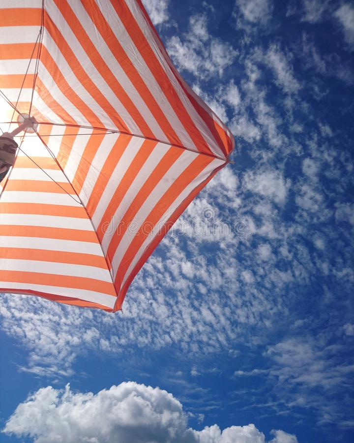 Sun umbrella. Enjoy summer holliday under a sun umbrella att The beach royalty free stock images