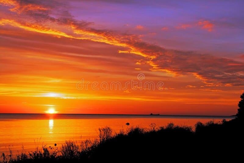 Sun vai para baixo imagem de stock