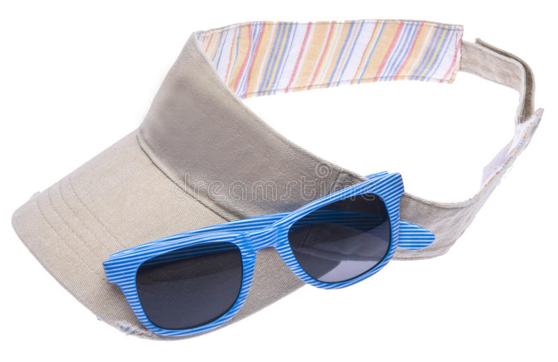 Sun Visor with Sunglasses. Neutral colored sun visor with bright blue sunglasses isolated on white with a clipping path royalty free stock image
