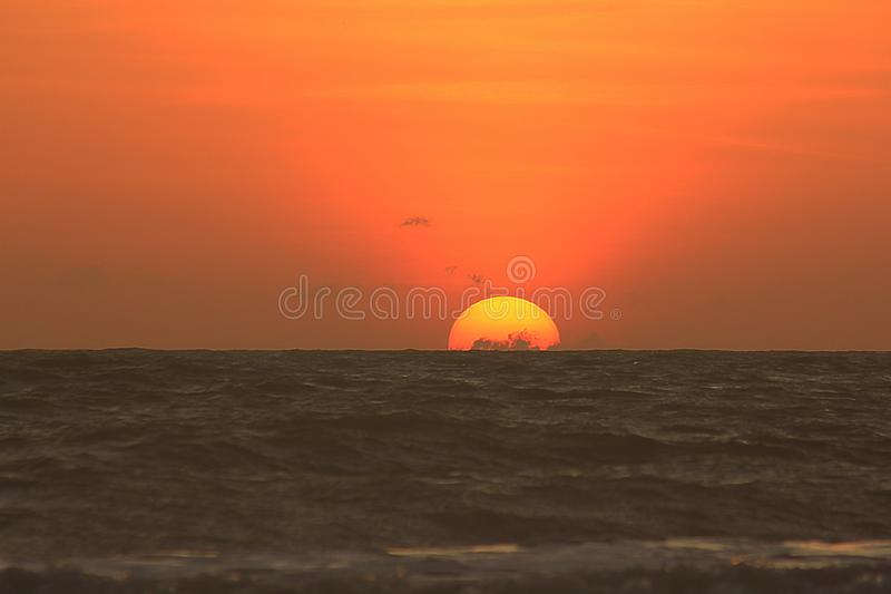 The sun is rising in the morning from the sea. The sun was rising in the early morning hours from the sea royalty free stock photography