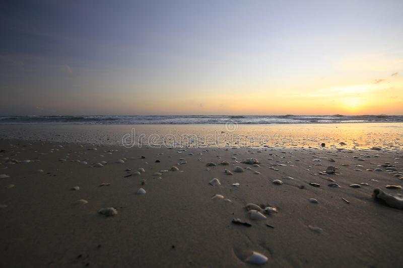 The sun is rising in the morning from the sea. stock photos