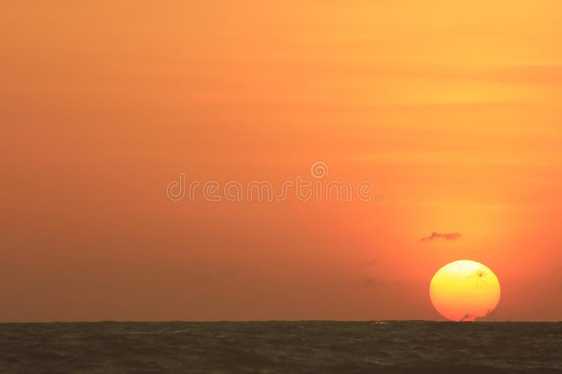 The sun is rising in the morning from the sea. royalty free stock photo