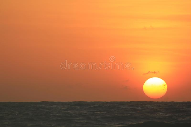 The sun is rising in the morning from the sea. royalty free stock photography