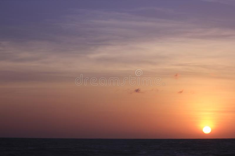 The sun is rising in the morning from the sea. stock photography