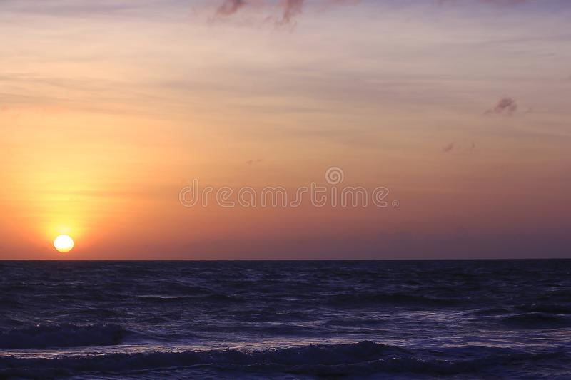 The sun is rising in the morning from the sea. stock images