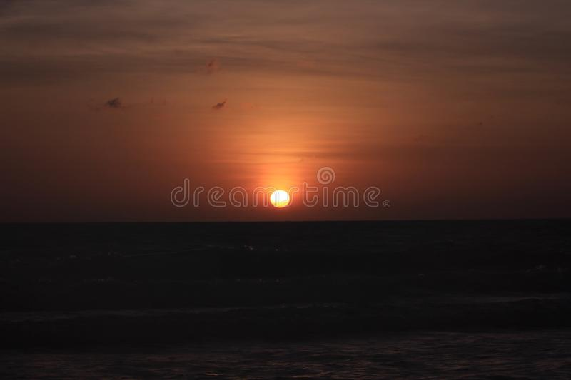 The sun is rising in the morning from the sea. stock image